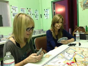 Emma, Anne and I, being given a run-through of Ticket to Ride Europe BEFORE THE BLOOSHED BEGAN!